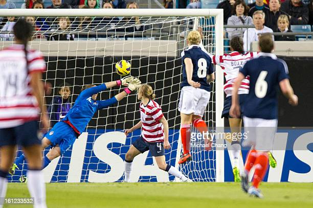 Goalkeeper Nicole Barnhart of the United States attempts to block a shot from midfielder Kim Little of Scotland in the second half during the first...