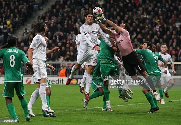 Goalkeeper Nir Davidovitch of Haifa saves the ball against Mario Gomez of Bayern during the UEFA Champions League Group A match between FC Bayern...