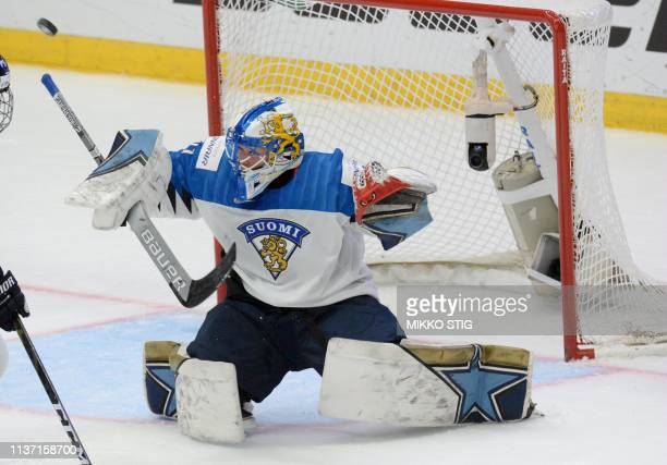 Goalkeeper Noora Raety of Finland makes a save during the IIHF Women's Ice Hockey World Championships final match between the United States and...