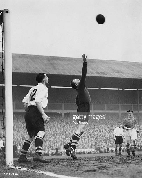 Goalkeeper Norman Heath of West Bromwich Albion tips the ball over the crossbar as team mate and full back Stan Rickaby looks on during the FA Cup...