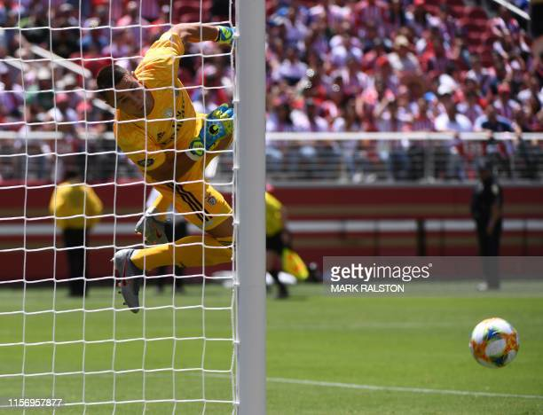 Goalkeeper Odysseas Vlachodimos of Benfica stops a shot on goal by Chivas de Guadalajara during their 2019 International Champions Cup match at the...