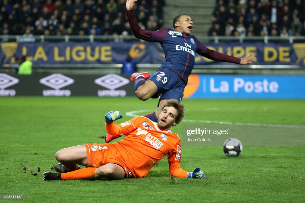 Goalkeeper of Amiens Regis Gurtner commits a foul on Kylian Mbappe of PSG and receives a red card during the French League Cup (Coupe de la Ligue) match between Amiens SC and Paris Saint Germain (PSG) at Stade de la Licorne on January 10, 2018 in Amiens, France.