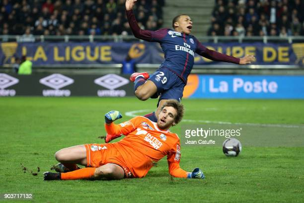 Goalkeeper of Amiens Regis Gurtner commits a foul on Kylian Mbappe of PSG and receives a red card during the French League Cup match between Amiens...