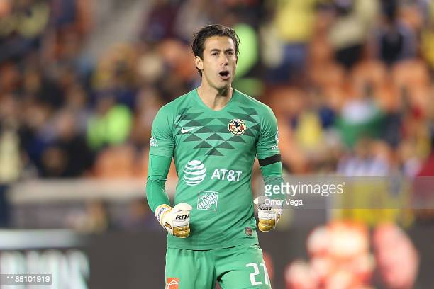 Goalkeeper of Club America Oscar Jimenez celebrates the first goal of his team scored by teammate Emanuel Aguilera during the friendly match between...