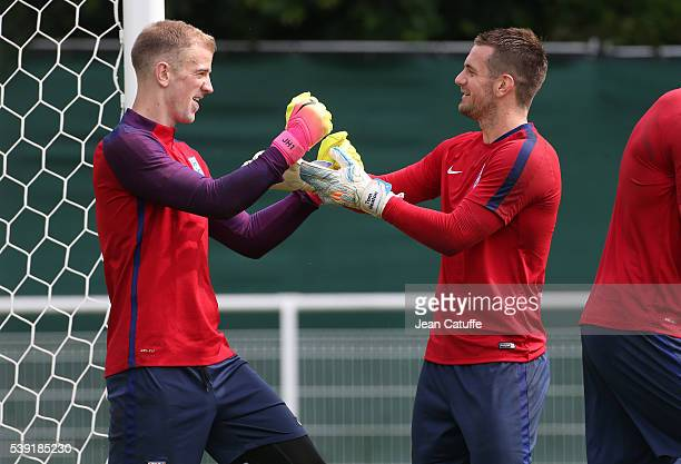 Goalkeeper of England Joe Hart jokes with team mate Tom Heaton during a training session ahead of the UEFA EURO 2016 at Stade des Bourgognes on June...