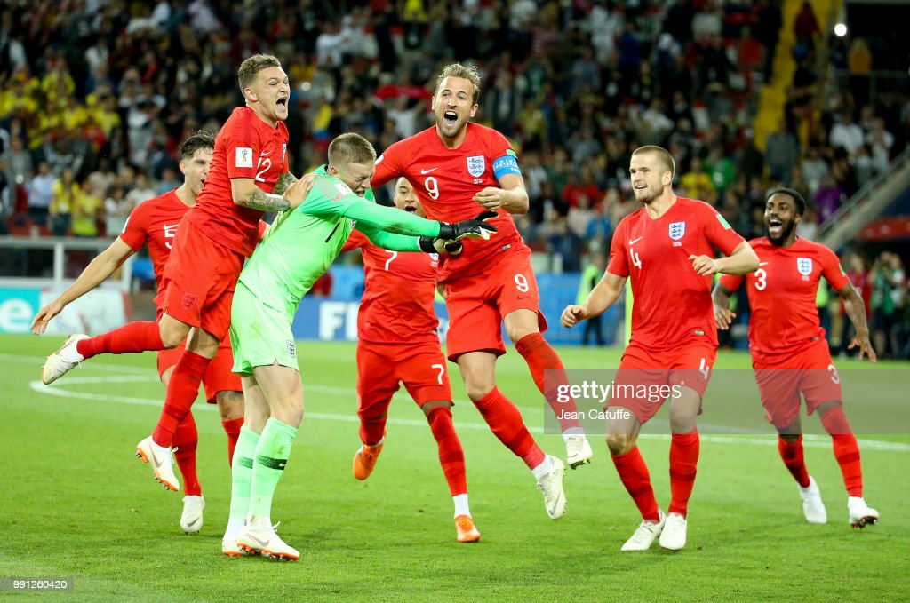 Goalkeeper of England Jordan Pickford is celebrated by teammates Kieran Trippier, Harry Kane, Eric Dier, Danny Rose of England after winning the penalty shootout of the 2018 FIFA World Cup Russia Round of 16 match between Colombia and England at Spartak Stadium on July 3, 2018 in Moscow, Russia.