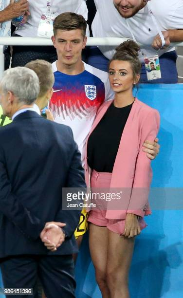 Goalkeeper of England Nick Pope and girlfriend Shannon Horlock following the 2018 FIFA World Cup Russia group G match between England and Belgium at...