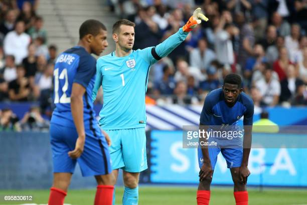 Goalkeeper of England Tom Heaton between Kylian Mbappe and Ousmane Dembele of France during the international friendly match between France and...
