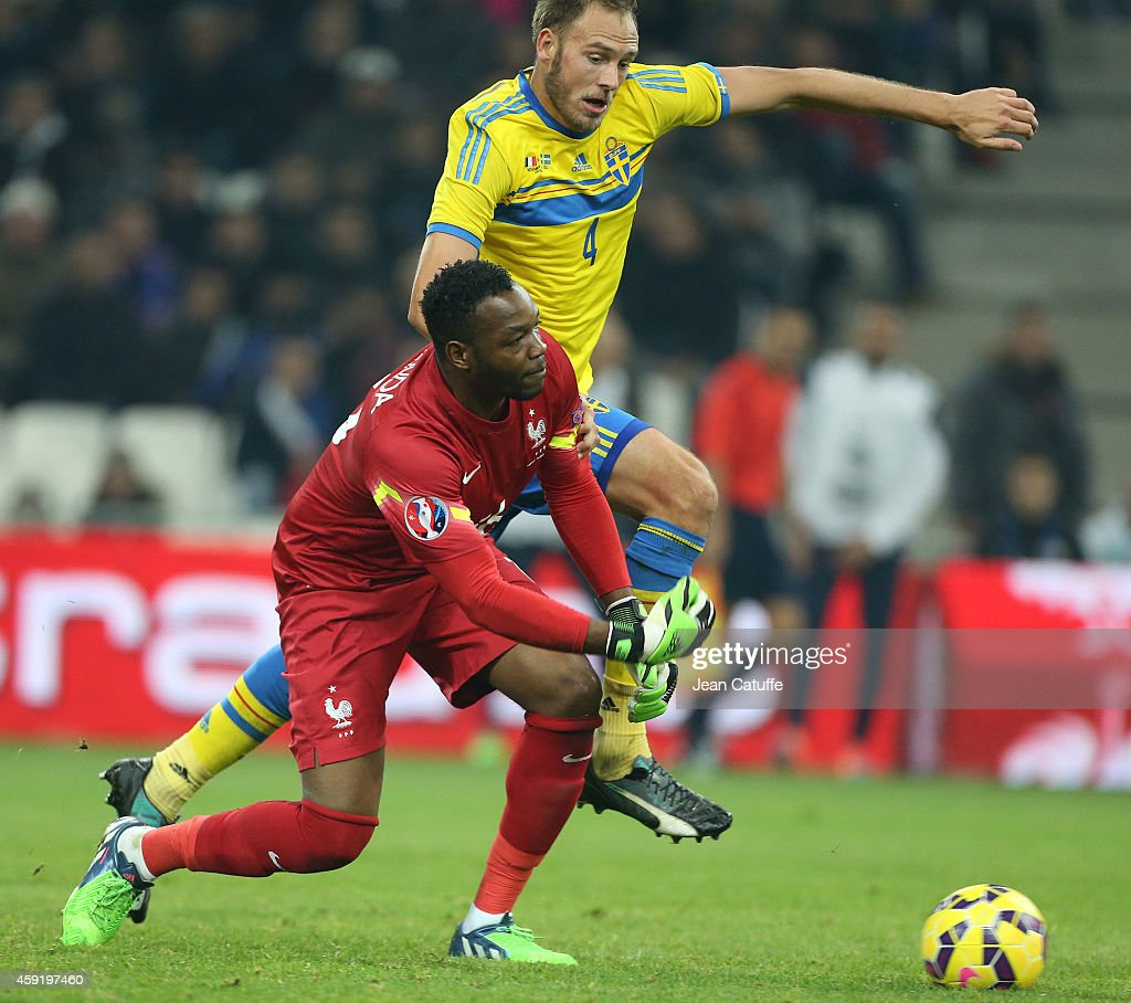 Goalkeeper of France Steve Mandanda and Andreas Granqvist of Sweden in action during the international friendly match between France and Sweden at the Stade Velodrome on November 18, 2014 in Marseille, France.