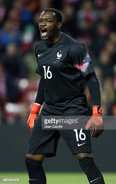 Goalkeeper of France Steve Mandanda reacts during the international friendly match between Denmark and France at Telia Parken Stadium on October 11...