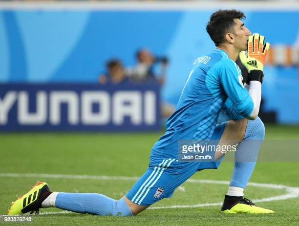 Goalkeeper of Iran Alireza Beiranvand reacts while his teammate shoots a penalty during the 2018 FIFA World Cup Russia group B match between Iran and...