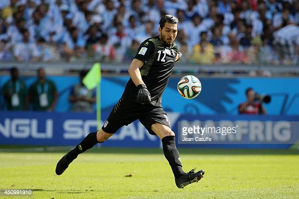 Goalkeeper of Iran Alireza Haghighi in action during the 2014 FIFA World Cup Brazil Group F match between Argentina and Iran at Estadio Mineirao on...