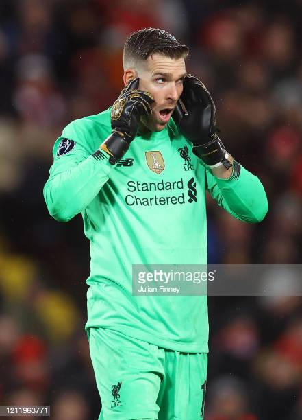 Goalkeeper of Liverpool Adrian checks his hearing after a knock to the head during the UEFA Champions League round of 16 second leg match between...
