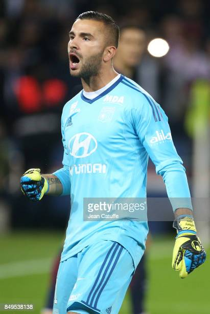 Goalkeeper of Lyon Anthony Lopes celebrates stopping the penalty of Edinson Cavani of PSG during the French Ligue 1 match between Paris Saint Germain...