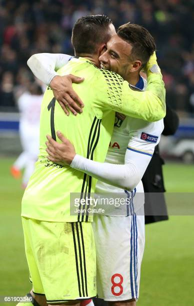 Goalkeeper of Lyon Anthony Lopes greets Corentin Tolisso following the UEFA Europa League Round of 16 first leg match between Olympique Lyonnais and...