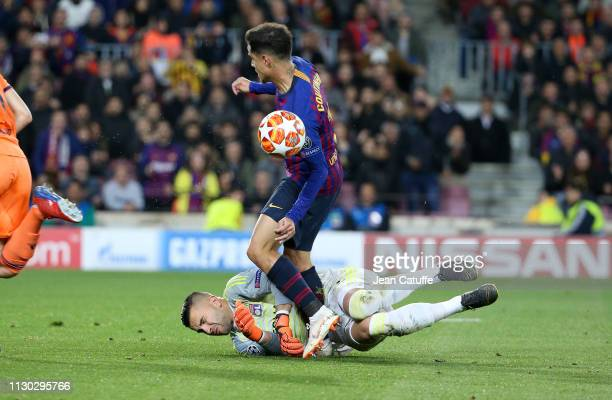 Goalkeeper of Lyon Anthony Lopes is injured after being hit by Philippe Coutinho of Barcelona during the UEFA Champions League Round of 16 Second Leg...