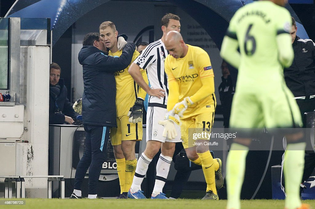 Goalkeeper of Manchester City Joe Hart is replaced by teammate Willy Caballero during the UEFA Champions League match between Juventus Turin and Manchester City FC at Juventus Stadium on November 25, 2015 in Turin, Italy.