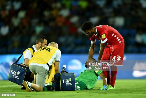 Goalkeeper of New Caledonia Une Kecine receives medical treatment during the FIFA U17 World Cup India 2017 group E match between New Caledonia and...