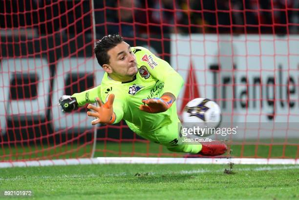 Goalkeeper of OGC Nice Yoan Cardinale stops a penalty during the penalty shootout of the French League Cup match between Lille OSC and OGC Nice at...