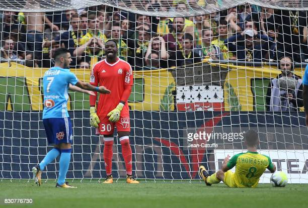 Goalkeeper of OM Steve Mandanda and Adrien Thomasson of Nantes during the French Ligue 1 match between FC Nantes and Olympique de Marseille at Stade...
