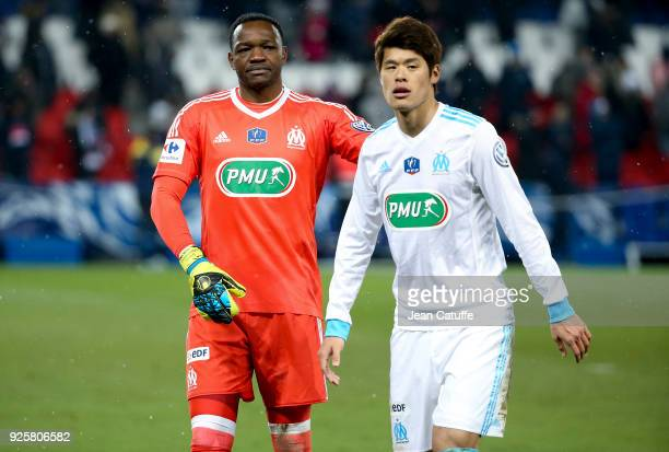 Goalkeeper of OM Steve Mandanda and Hiroki Sakai of OM salute the supporters of Marseille following the French National Cup match between Paris Saint...