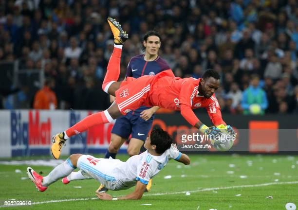 Goalkeeper of OM Steve Mandanda collides with teammate Hiroki Sakai of OM while Edinson Cavani of PSG looks on during the French Ligue 1 match...