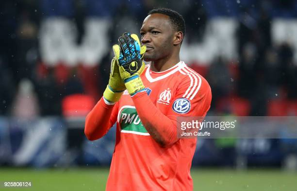 Goalkeeper of OM Steve Mandanda salutes the supporters of Marseille following the French National Cup match between Paris Saint Germain and Olympique...