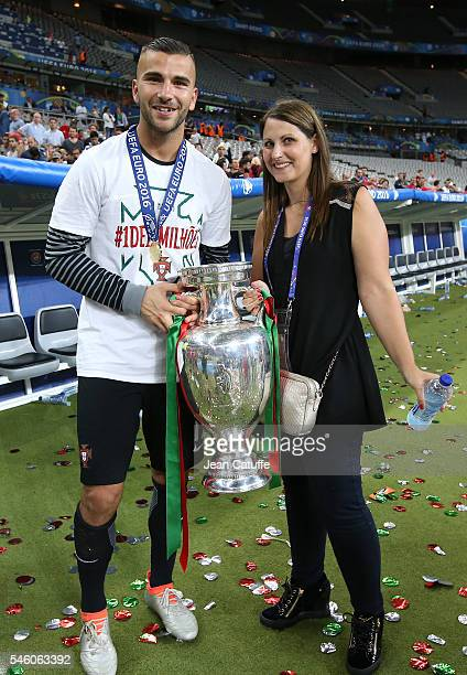 Goalkeeper of Portugal Anthony Lopes and his wife pose with the trophy following the UEFA Euro 2016 final match between Portugal and France at Stade...