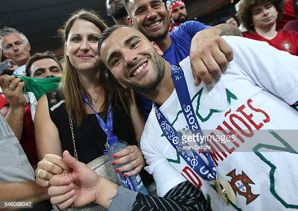 Goalkeeper of Portugal Anthony Lopes poses with his wife following the UEFA Euro 2016 final match between Portugal and France at Stade de France on...