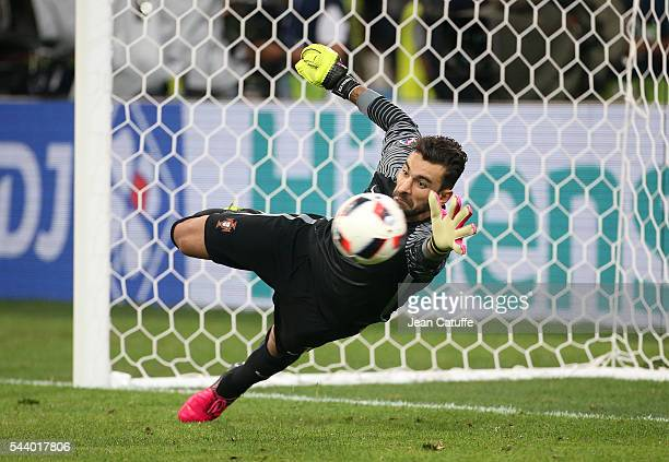 Goalkeeper of Portugal Rui Patricio stops the penalty of Jakub Blaszczykowski of Poland during the penalty shootout leading to the victory of...
