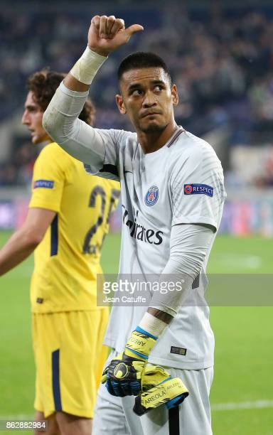 Goalkeeper of PSG Alphonse Areola salutes the fans and celebrates the victory following the UEFA Champions League match between RSC Anderlecht and...