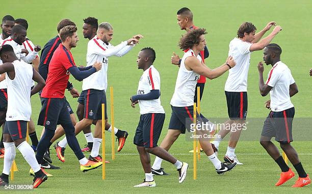 Goalkeeper of PSG Kevin Trapp Layvin Kurzawa Hervin Ongenda David Luiz Maxwell Scherrer warm up during the first training session of the season at...