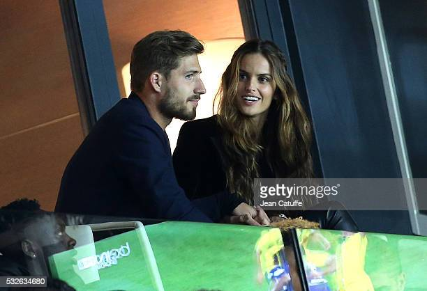 Goalkeeper of PSG Kevin Trapp of Germany and his girlfriend brazilian top model Izabel Goulart attend the French Ligue 1 match between Paris...