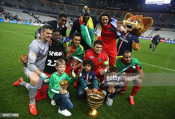 Goalkeeper of PSG Nicolas Douchez Serge Aurier Marquinhos Thiago Silva Edinson Cavani Lucas Moura of PSG celebrate the victory after the French...