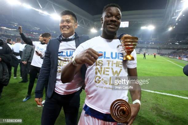 Goalkeeper of Strasbourg Eiji Kawashima LamineGueye Kone celebrate the victory following the French League Cup final between Racing Club de...