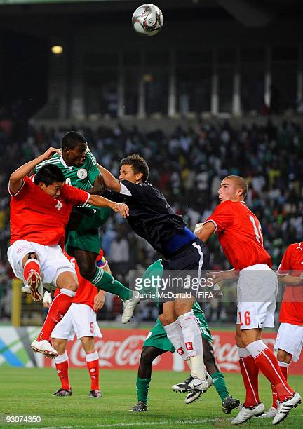 Goalkeeper of Switzerland Benjamin Siegrist saves from the head of Sani Emanuel of Nigeria during the FIFA U17 World Cup Final match between...