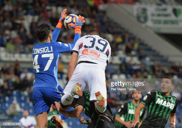 Goalkeeper of US Sassuolo Andrea Consigli competes for the ball with Andrea Favilli of Genoa CFC during the serie A match between US Sassuolo and...
