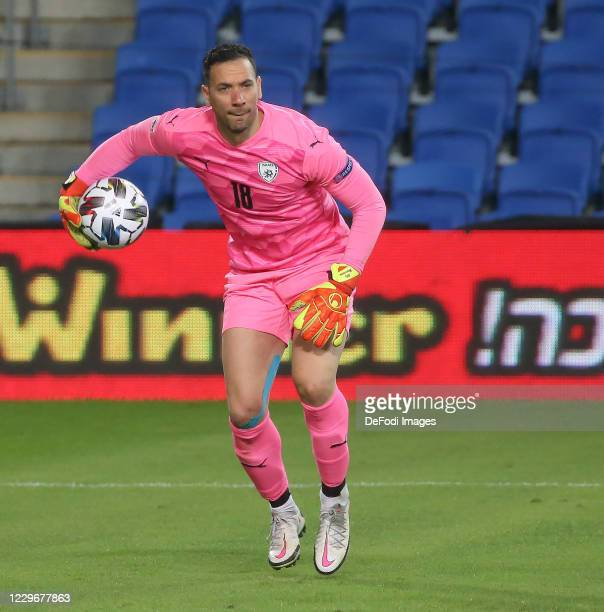Goalkeeper Ofir Marciano of Israel controls the ball during the UEFA Nations League group stage match between Israel and Scotland at Netanya Stadium...