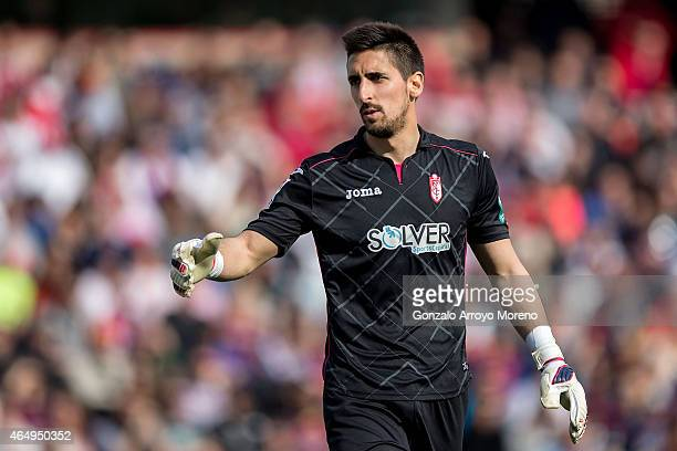 Goalkeeper Oier Olazabal of Granada CF points during the La Liga match between Granada CF and FC Barcelona at Nuevo Estadio de los Carmenes on...