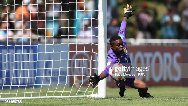 Goalkeeper Olga Ngo Esse of Cameroon tries to save a penalty during the FIFA U17 Women's World Cup Uruguay 2018 group C match between USA and...