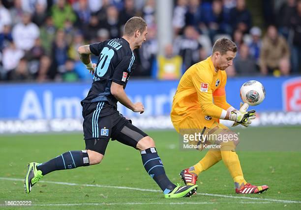 Goalkeeper Oliver Baumann of Freiburg makes his second mistake during the Bundesliga match between SC Freiburg and Hamburger SV at Mage Solar Stadium...