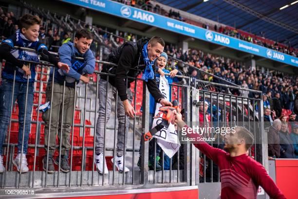 Goalkeeper Oliver Baumann of Hoffenheim gives his goalkeeper gloves to a fan after winning the Bundesliga match between Bayer 04 Leverkusen and TSG...
