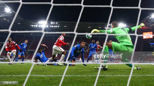 Goalkeeper Oliver Baumann of Hoffenheim tries to save a shot from Jeremiah St. Juste of Mainz during the Bundesliga match between 1. FSV Mainz 05 and...