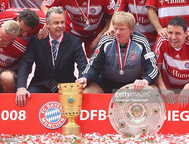 Goalkeeper Oliver Kahn and his head coach Ottmar Hitzfeld pose with the German Championship trophy and the DFB Cup trophy after the Bundesliga match...