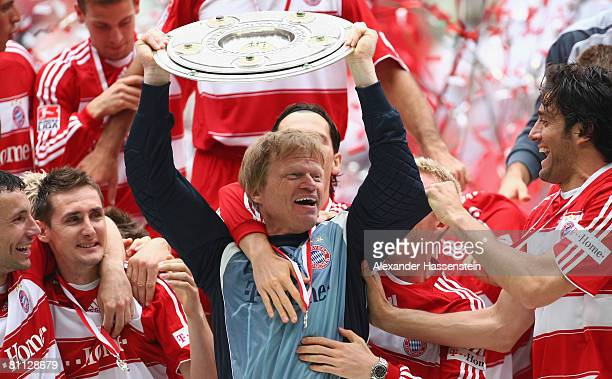 Goalkeeper Oliver Kahn lifts the German Championship trophy after the Bundesliga match between FC Bayern Munich and Hertha BSC Berlin at the Allianz...