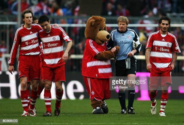 Goalkeeper Oliver Kahn of Munich celebrates with the mascot after winning the Bundesliga match between Bayern Munich and Bayer Leverkusen at the...