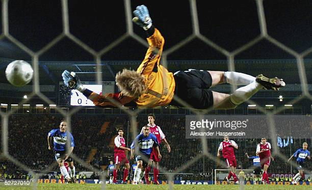 Goalkeeper Oliver Kahn of Munich dives to make a save during the DFB Pokal Semi Final Match between Arminia Bielefeld and Bayern Munich at the...