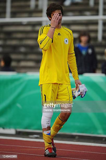 Goalkeeper Oliver Schnitzler of Germany leaves the pitch injured after the DFB U17 Four Nations Cup match between Germany and Netherlands at...