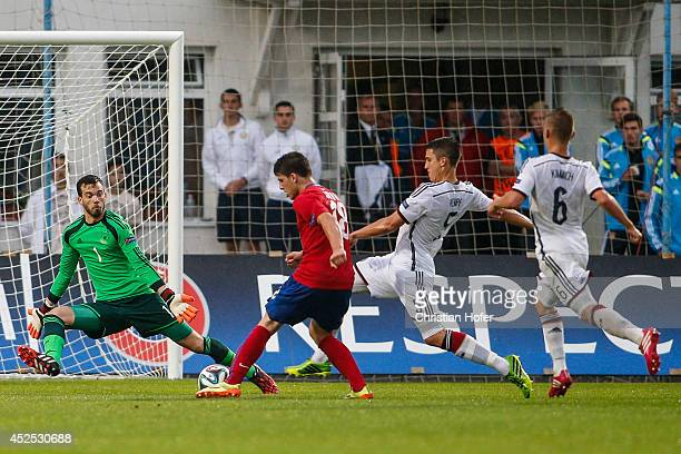 Goalkeeper Oliver Schnitzler of Germany makes a save against Luka Jovic of Serbia during the UEFA Under19 European Championship match between U19...