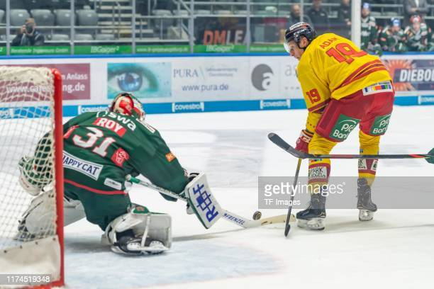 goalkeeper Olivier Roy of Augsburger Panther and Luke Adam of Dueseldorfer EG battle for the ball during the DEL match between Augsburger Panther and...